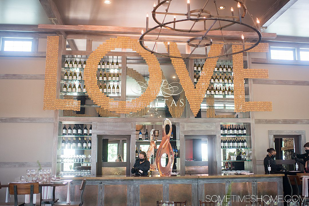 Photo of LOVE cork sign above the bar at Vineyard and winery in Charlottesville, Virginia near the Blue Ridge Mountains.
