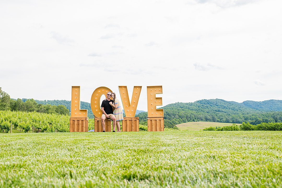 LOVE sign with the mountains in the background.