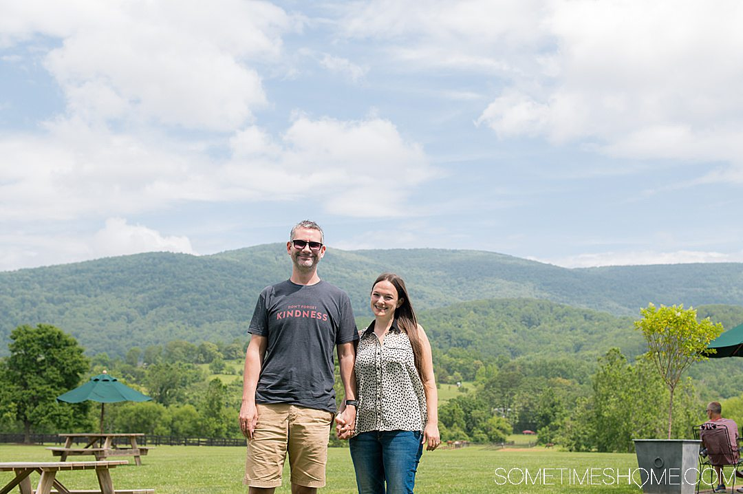 Couple in front of the Blue Ridge Mountains at King Family Vineyard.